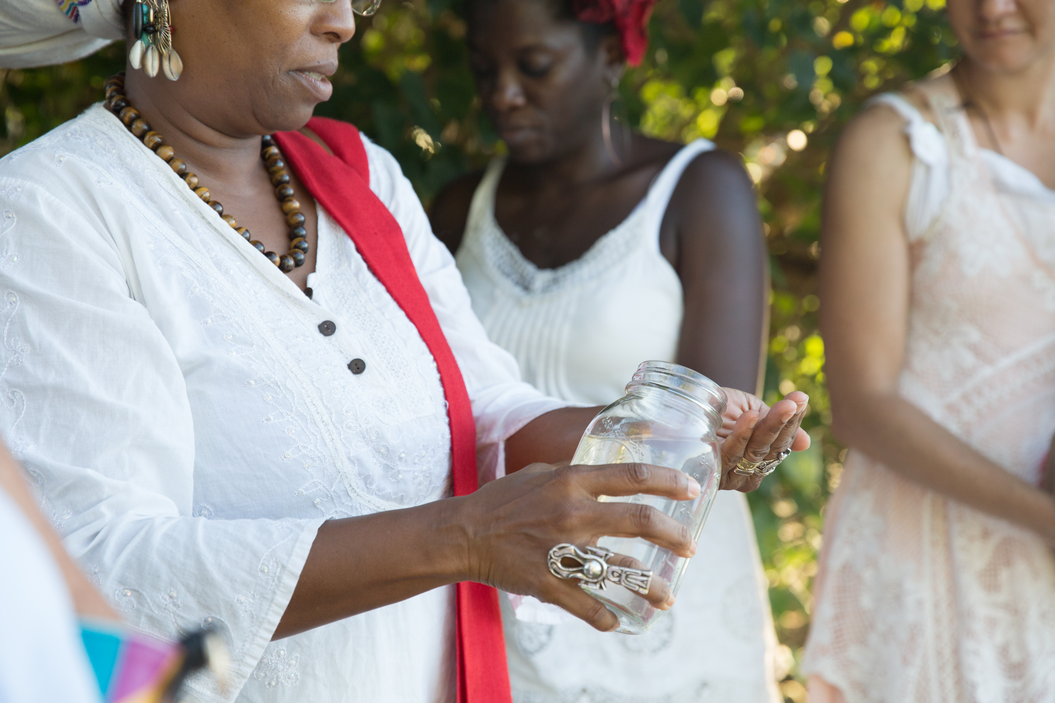 At the bayside in St. Croix, we passed a jar of sea water among us, each offering a wish or hope or blessing back to the sea. Dr. Chenzira Davis-Kahina pours water on her hands as part of her ritual. Fishtrap collaborator Oceana James and Paloma McGregor stand in the background.