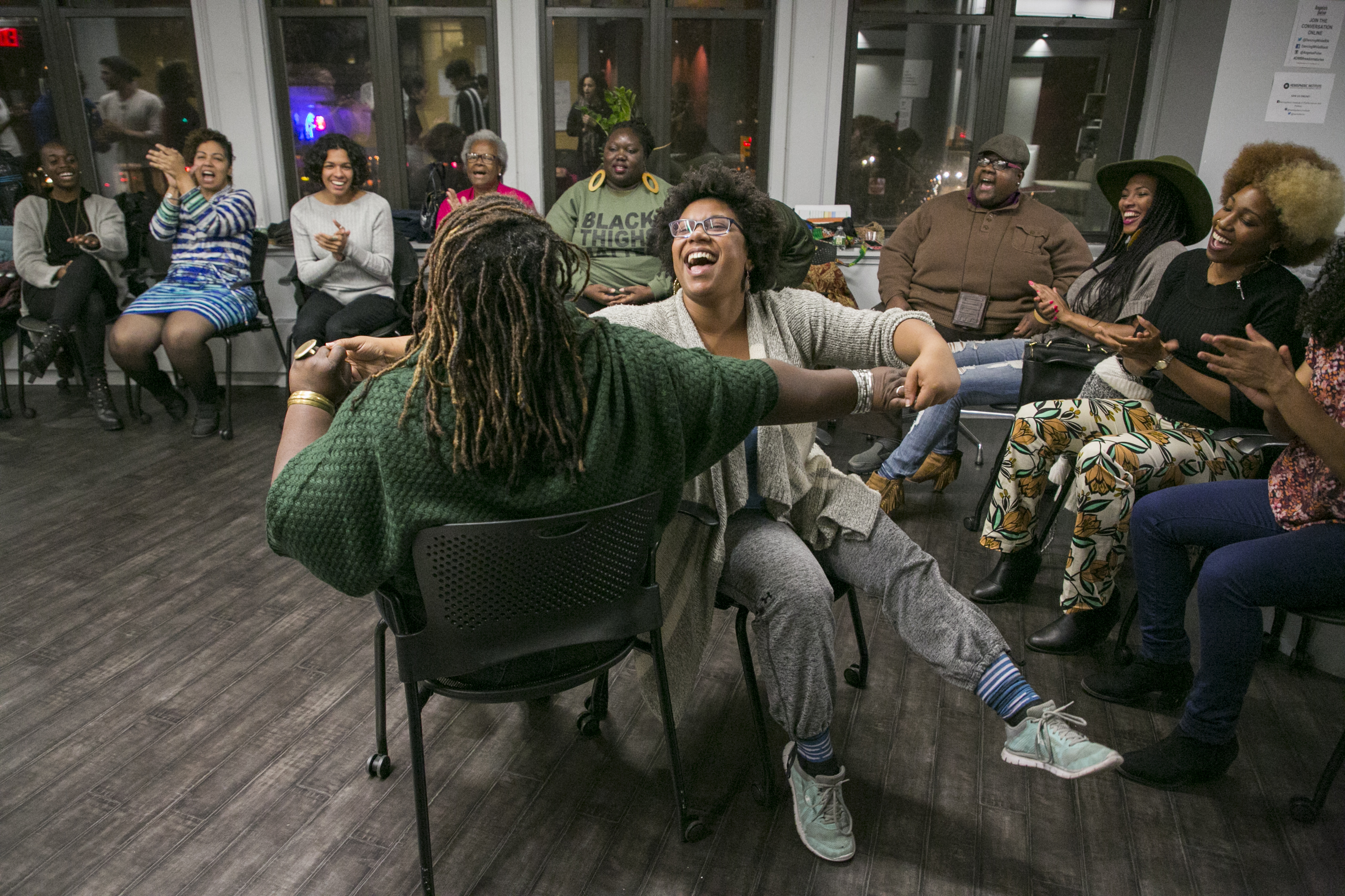 Ebony Noelle Golden and Sydnie L. Mosley ('15-'16 DWB Fellow) share a moment of pure joy surrounded by a circle of Dancing While Black community members at Dancing While Black: This Body Knows Freedom - Story Circles on Organizing toward Vision in an Age of Resistance at NYU's Hemispheric Institute in November 2017.